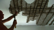 Stock Video Footage of Repairing corroded metal rods in ceiling 2
