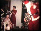 Santa Claus Passing Out Gifts (1962 - Vintage 8mm film) Stock Footage