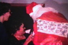 Santa Claus Gives Doll To Girl (1962 - Vintage 8mm film) Stock Footage