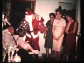 Stock Video Footage of Santa Claus Arrives With Gifts (1962 - Vintage 8mm film)