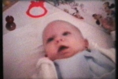 Baby Wearing New Sweater (1962 - Vintage 8mm film) Stock Footage