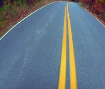 Driving along yellow line - wide shot Stock Footage