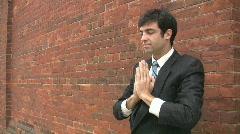 Businessman meditates. Stock Footage