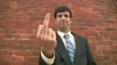 Businessman giving the finger. Stock Footage