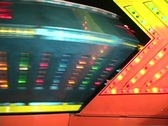 Spinning Ship Carnival Ride during Fireworks (unseen) Alien Retro Stock Footage