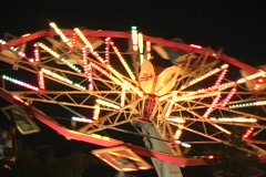 Startrooper carnival ride at night, lighted - stock footage