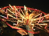Startrooper carnival ride at night, lighted Stock Footage
