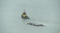 Stock Video Footage of tug pulls barge