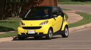 Stock Video Footage of smart car drives right