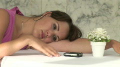 Girl waiting for a call Stock Footage