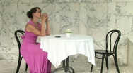 Girl Sitting Alone At A Table In A Restaurant Stock Footage