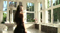 Young Woman In A Black Dress Comes In A Luxurious Room Footage