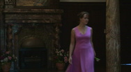 Girl With A Flower In Her Hand Goes Across The Hall Stock Footage