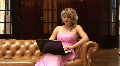 HD1080i Young blonde woman in evening dress sitting on couch and working with Footage