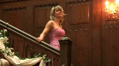 HD1080i Young blonde woman in evening dress pink walking down stairs. Part 3 Stock Footage