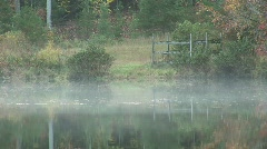 pond with steam rising close - stock footage