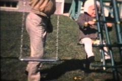 Little Boy On The Swings (1963 - Vintage 8mm film) - stock footage