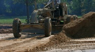 Stock Video Footage of Grader spreading dirt around on construction site