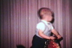 Little Boy Happy On His Horsey (1963 - Vintage 8mm film) Stock Footage