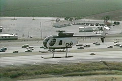 CHP Helicopter Flies over Freeway - stock footage