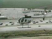 Stock Video Footage of CHP Helicopter Flies over Freeway