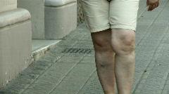 Fat woman walking Stock Footage