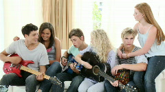 Group of teenagers playing guitar at home Stock Footage