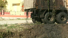 Silt pouring from truck after dredging canal 1 Stock Footage