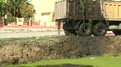 Silt pouring from truck after dredging canal 2 Stock Footage