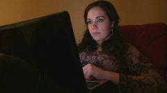 Girl browsing Internet on Laptop Stock Footage