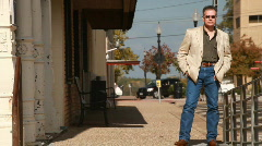 Man walking around the corner of a busy street Stock Footage
