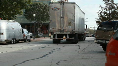Editorial semi truck traveling through a small town Stock Footage