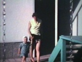 Stock Video Footage of Mom And Little Boy Outside (1963 - Vintage 8mm film)