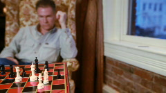 Dolly man playing chess checkmate Stock Footage