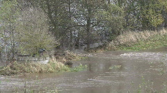 River Tees breaks through a flood bank Stock Footage