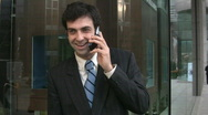 Businessman laughs on cellphone. Stock Footage