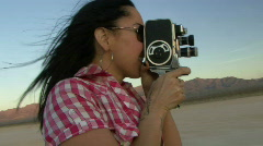 Female in desert using a cine camera Stock Footage