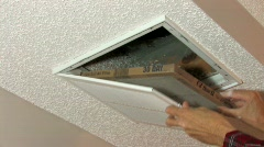 Replacing a ceiling air filter - stock footage