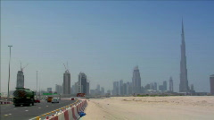highway traffic at dubai skyline burj - stock footage