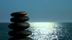 Stack of Zen rocks against ocean V1 - HD - stock footage