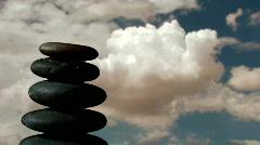 Stack of Zen rocks against cloud timelapse - HD Stock Footage