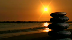 Stack of Zen rocks against ocean sunset - HD Stock Footage
