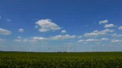 Rape field Wind Turbines Alternative Green Clean energy - stock footage