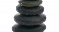 Stock Video Footage of Stack of Zen rocks zoom out - HD