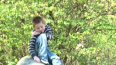 Boy Posing on Rock for Picture Stock Footage