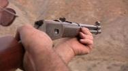 Man Shooting a Gun / Rifle / 308 Stock Footage