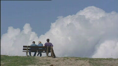 Dike_people_bench_cloud_502001 015951 Stock Footage