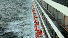 Ship starboard balconies lifeboats ocean P HD 4334 Stock Footage