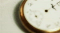 rack focus of a ticking antique pocket watch - stock footage