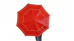 Nice girl isolated with umbrella - stock footage